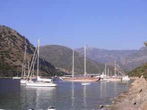 A Turkish gulet docks with private yachts in a inlet in Turkey