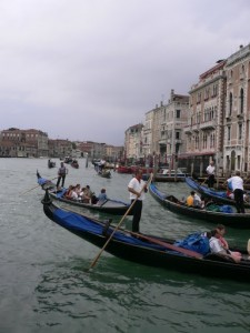 Tourists take a gondola ride in Venice, Italy