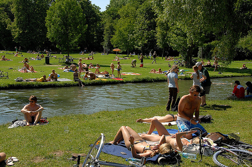 Locals and tourists enjoy Munich's Englischer Garten
